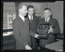 Portland Mayor Joseph K. Carson presenting plaque to Junior Chamber of Commerce representatives?