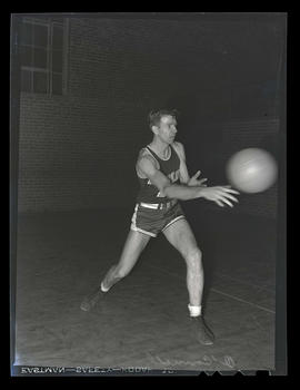 Claude? O'Connell, basketball player for Albina Hellships, passing ball
