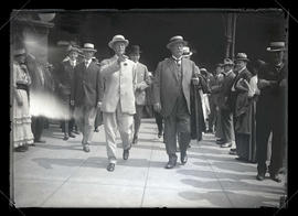 William Howard Taft walking with reception committee after arriving in Portland
