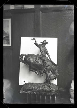 Statue of cowboy on bucking bronco