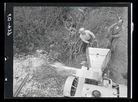 Men with wood chipper