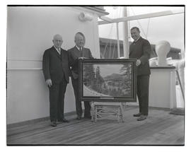 Three unidentified men with painting of Columbia River near Bonneville, Oregon