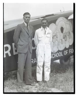 Unidentified man and Dick Rankin with airplane On-to-Oregon
