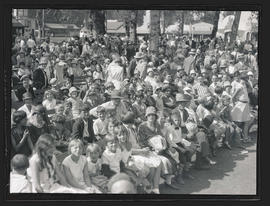 Crowd of people sitting on benches at Jantzen Beach amusement park, Portland?