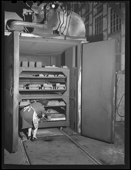 Mrs. Shofner cooking beans at Shofner Iron and Steel Works, Portland