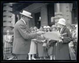 George L. Baker and unidentified woman during ceremony at Portland City Hall