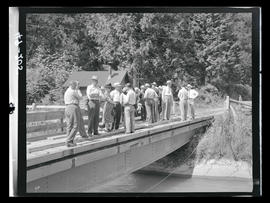 Group standing on bridge