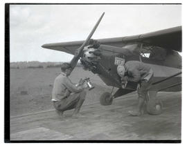 Two unidentified men working on Bidwell-Yale Air Service plane