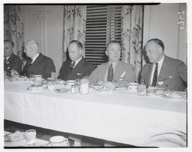 Unidentified men dining during convention