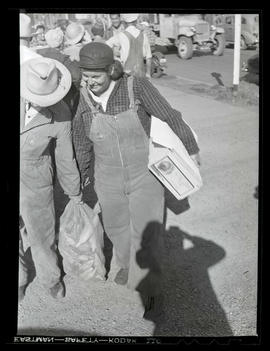 Workers carrying produce during market at Albina Engine & Machine Works, Portland