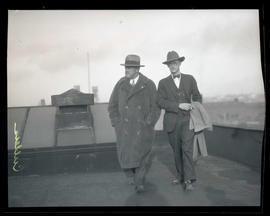 Cullers and unidentified man on rooftop or balcony