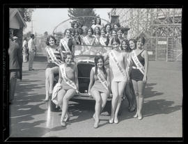 Beauty contestants posing with car at Jantzen Beach