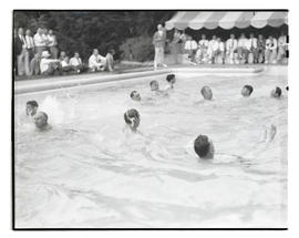 Portland Breakfast Club members in swimming pool at midsummer party