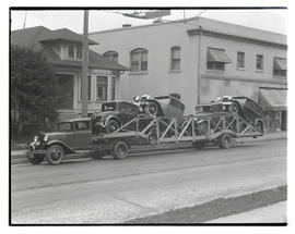 Truck with trailer carrying cars