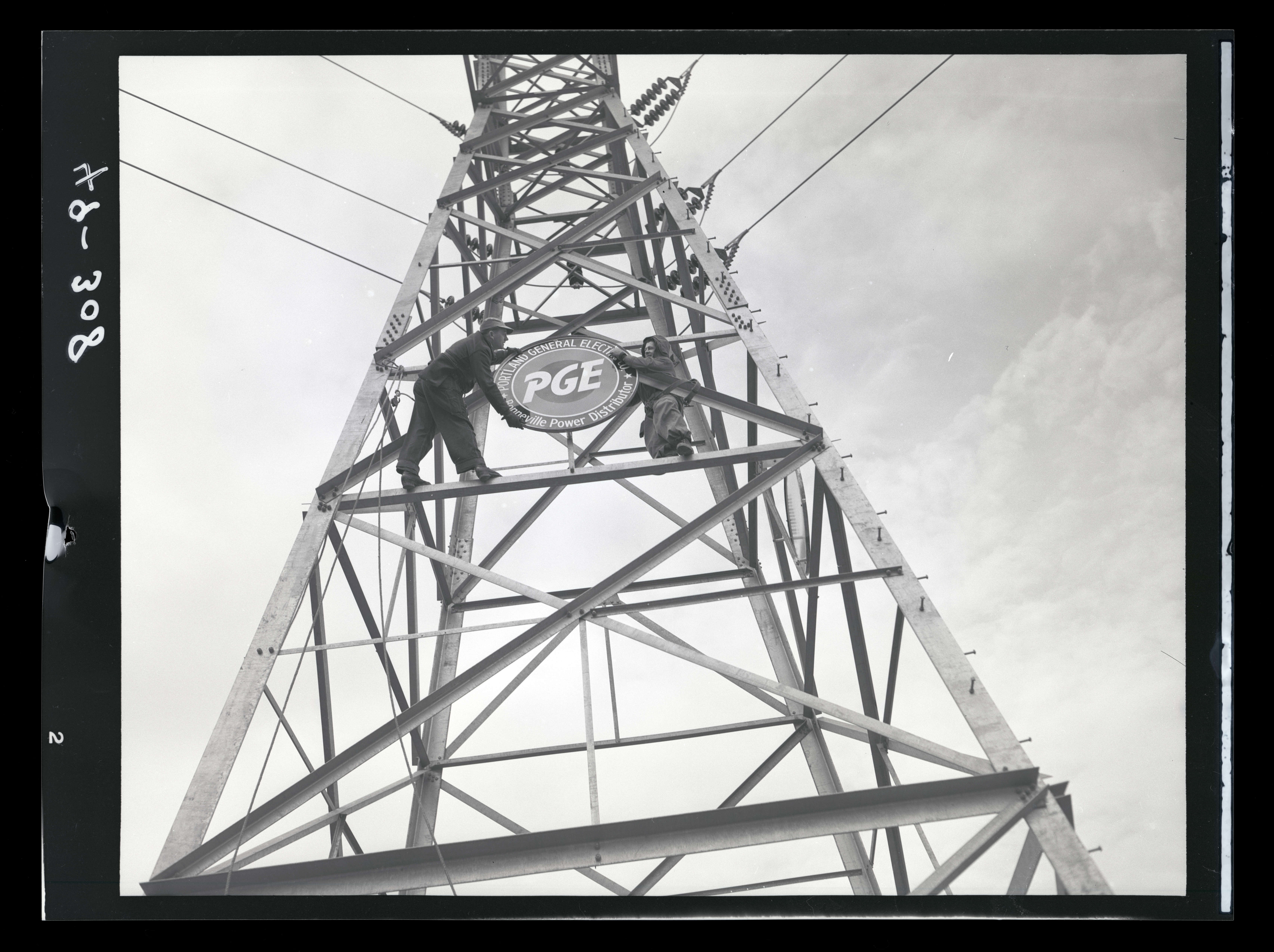 Men With Portland General Electric Sign On Transmission Tower Ohs Digital Collections
