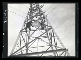 Men with Portland General Electric sign on transmission tower