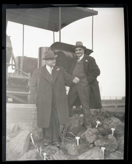 George L. Baker and unidentified man with Oregon Pony locomotive, Union Station, Portland