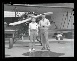Mr. and Mrs. Robert Crawford with airplane