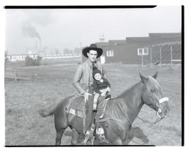 Man and child on horseback