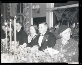 Joseph K. Carson seated at dining table during formal event