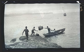 Offloading supplies on Three Arch Rocks