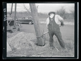 Man working with utility pole