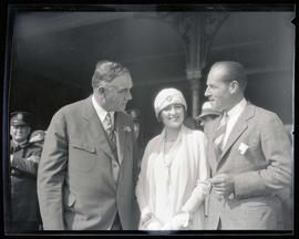 Unidentified woman and man with George L. Baker at Union Station, Portland