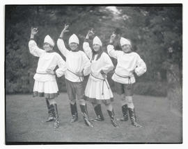 Four young people in costume, posing outdoors