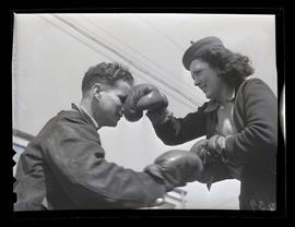 Two workers boxing at Albina Engine & Machine Works, Portland