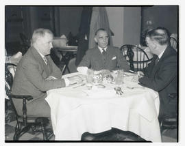 Willem van Hoogstraten at dining table with two unidentified men