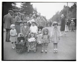 Children in street with doll carriages