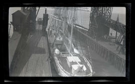 Four-masted sailing ship at pier