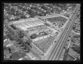 Aerial view of Fred Meyer store built around home in Roseway, Portland