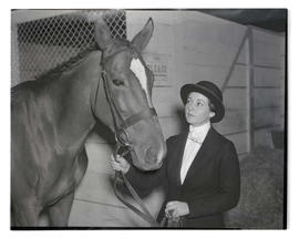 Unidentified woman with horse, probably at Pacific International Livestock Exposition