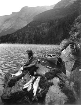Fishing at Lake St. Mary's Glacier Park, Montana, circa 1910