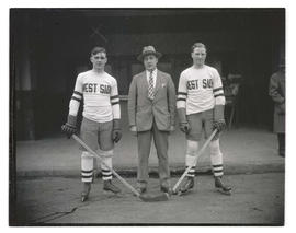 Two West Side hockey players with unidentified man