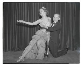 Two young tap dancers posing in costume