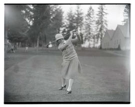 Golfer posing with club