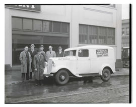 Group of men with truck advertising Churn-Maid Tuna Spred