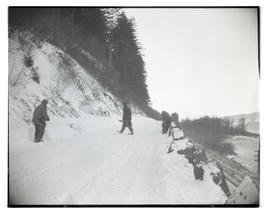 Unidentified people shoveling snow on Columbia River Highway