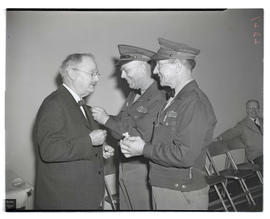Man receiving pin during Portland Gas & Coke Co. celebration
