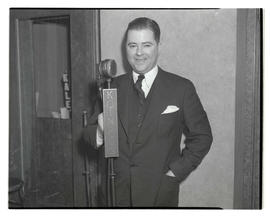 J. Parker, standing at KOIN microphone
