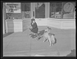 Child with dog on Southeast Hawthorne Boulevard