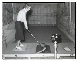 Golf student using training device