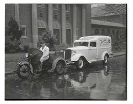 Tarola Motor Car employees with vehicles outside St. Mary's Cathedral, Portland