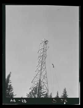 Men building transmission tower