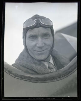 H. W. Angell in airplane cockpit