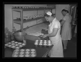 Kitchen workers with dough at Kaiser Company restaurant