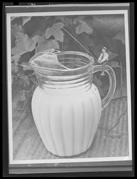 Composite photograph of person fishing in a pitcher of milk at Albina Engine and Machine Works