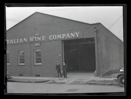 Two men outside Italian Wine Company, Southeast 8th Avenue, Portland